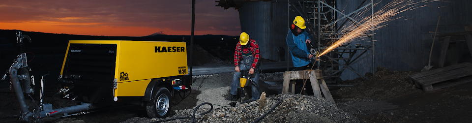 Workers using Kaeser Compressors equipment
