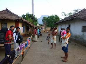 Photo: Richard Kher feeling giggly, while Rahul Lama looks on, early in the morning before we left the village for Chanderi looming in the background.