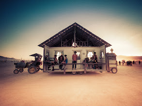 Photo: Home Where the Buffalo Roam  A house is pulled across the desert as people sit on the porch to drink iced tea and various other beverages...  BTW, about to start up a fun Burning Man photo trivia contest here athttp://www.StuckInCustoms.com -- have to get on a plane now but will get it going ASAP :)