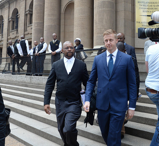 Gareth Cliff leaves court with his lawyer, Advocate Dali Mpofu.