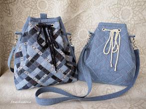 Photo: Джинсовые сумки-рюкзаки, высота 30 и 32 см. Левый сшит из старых джинсов, использована техника плетения из полосок. Правый - из обычной джинсовой ткани, отделка - декоративная строчка, имитирующая плетёнку.