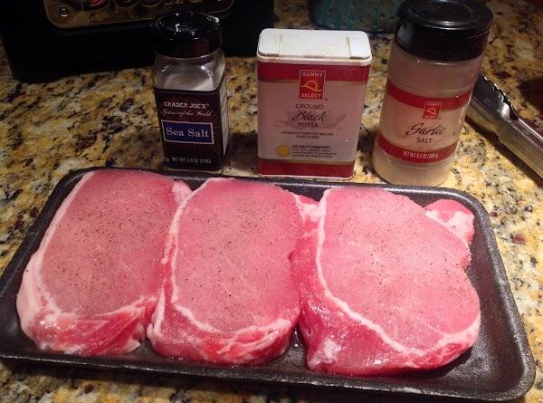 Season pork chops with salt, pepper and garlic salt to taste.