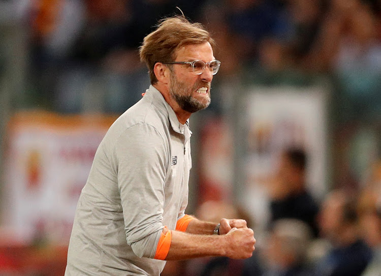 Liverpool manager Juergen Klopp celebrates after Sadio Mane scores their first goal during the Uefa Champions League semi final second leg match against AS Roma at the Stadio Olimpico in Rome on May 2, 2018.