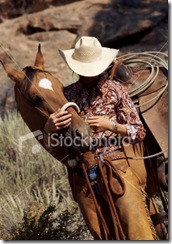 ist2_3001780_cowgirl_and_her_horse
