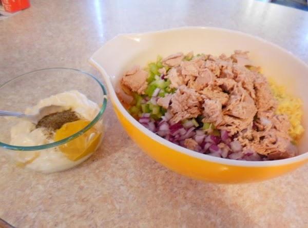 Put drained, still warm macaroni in large bowl, add tuna, chopped onion and celery...
