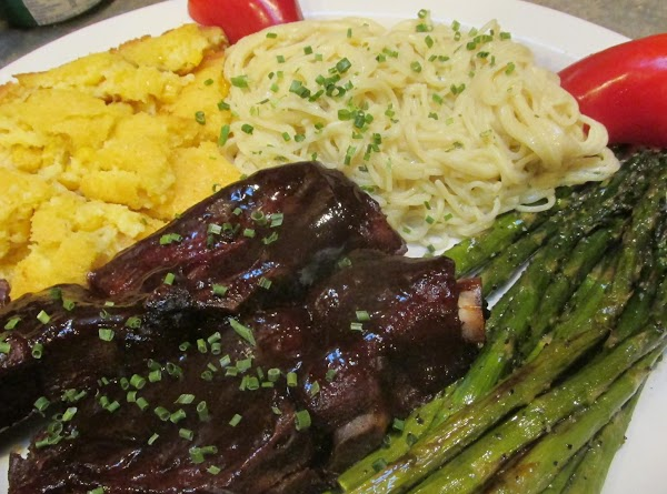 This is a Plate of Black Truffle Oil Roasted Asparagus, along with Oven Baked Country Style B B Q Ribs with Sweet Baby Rays Barbeque sauce,Corn Souffle, and Angel Hair Pasta  with a creamy Parmesan Cheese sauce, this was my husbands dinner plate.