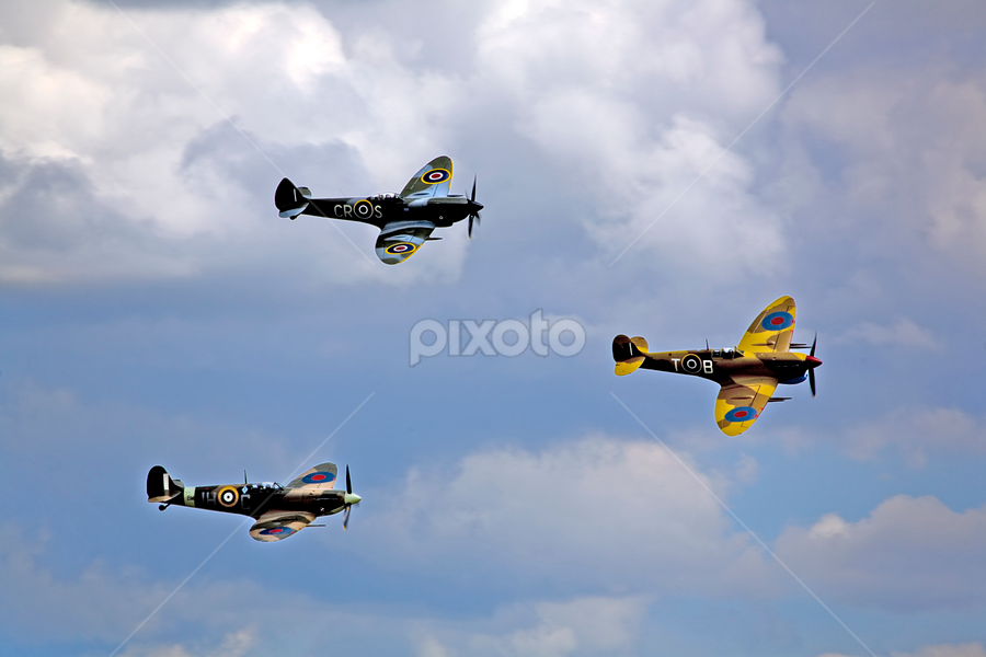 Historic Royal Airforce Planes Flying in Formation at Duxford UK by Joanne Santillo - Transportation Airplanes ( history, flight, spitfire, memorial, transport, aeroplane, air, ww ii, historic, military )
