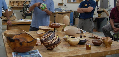 "Photo: The Show & Tell table, with Mark Sfirri discussing a ""stoned"" flower bowl by Ed Karch."