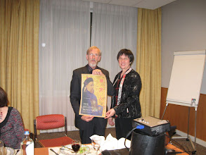 Photo: Anne presented Christian with a poster signed by all present.