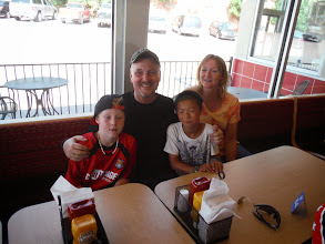 Photo: Day 23 Lusk WY to Hot Springs SD 93 miles, 2300' climbing: Jim, Valery and son's Sterling and Pierce treat us to DQ. Jim, an attourney inspired by 9/11/2001, gave up his practice and joined the Army (unit 4/27) and served in Baghdad Iraq. He was deployed shortly after Sterling was born.
