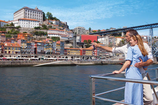 queen-isabel-on-deck.jpg - Take in views of centuries-old landmarks during your Douro River cruise on Uniworld's Queen Isabel.