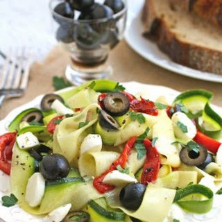 "Chilled Zucchini Ribbon ""Pasta"" with Black Olives, Roasted Red Peppers and Mozzarella"