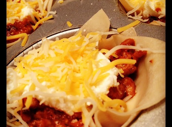 Top with half of the meat sauce then sprinkle with shredded cheese.Press another wonton...