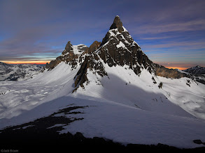Photo: Full moon light illuminates Ruchstock (2812m) and Hasenstock - Swiss Alps, February. In this 30-second exposure, at the left is the last light of dusk, and at the right is the glow of city lights under low cloud cover.