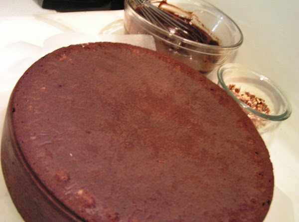 Frost the top and sides of the upside-down cake and sprinkle with the chopped...