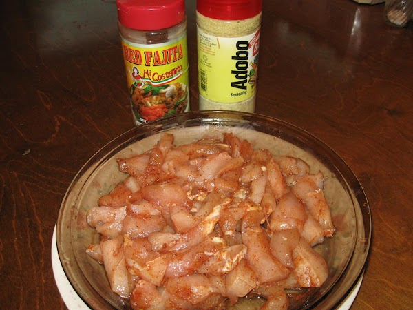Cut chicken breast into thin 2 inch long strips and add 1/2 tsp fajita...