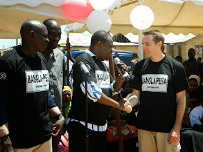 Photo: Will Ruddick shaking hands with Minister of  Parliament Hon. Badi Twalib