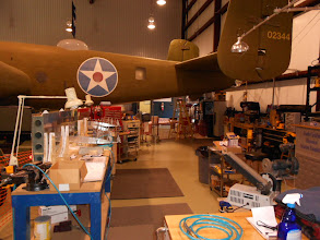 Photo: Ther rear of the B-25 overhangs the work area