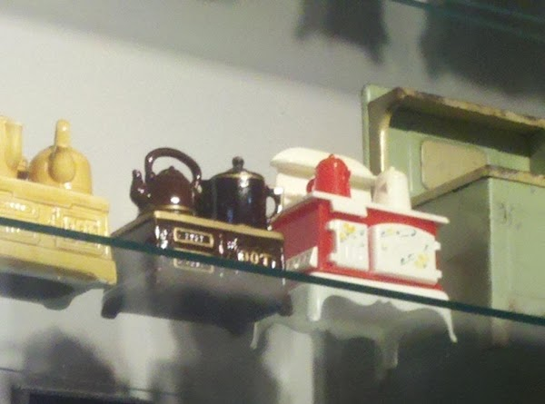 One interesting display was a collection of miniature stoves.