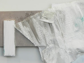 Photo: detail: WHITE GRID/PAPER UNDULATING showing stenciling and packing material