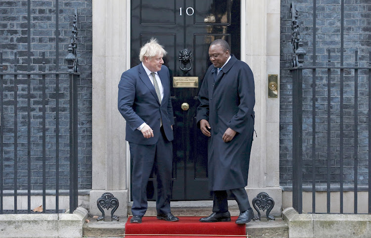 UK Prime Minister Boris Johnson and President Uhuru Kenyattaafter at a past joint press conference in London.