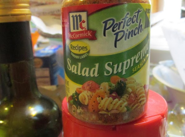 Add the full bottle of the McCormick salad supreme, sprinkling over the entire salad.