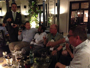 Photo: Ramesh and Mike Haley enjoying some wine with Adam Whalley and Colin Nuckolls