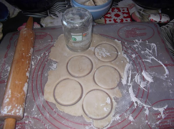 With a cookie cutter, or glass (I use a glass jar), cut dough into...