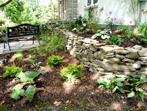 Photo: A lovely sitting area allows the homeowner to sit IN the garden and enjoy its beauty.