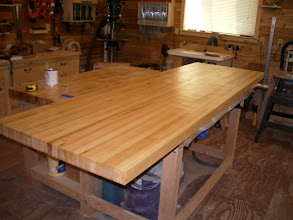 """Photo: I mentioned earlier that the plywood top was just temporary, well here's the new top - 30""""w x 8'l x 2 1/8"""" thick, laminated maple. Most of my previous laminating jobs have been less than stellar, but this one came out pretty good!"""