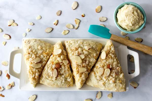 A Platter Of Almond Crumb Scones With Honey Butter.