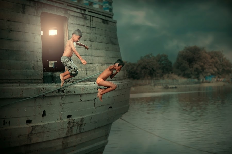 jumping on the river by Ari Sapto - People Street & Candids