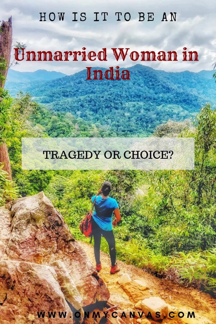 an indian woman standing in taman negara national park of malaysia and thinking image to show an indian woman's struggle of staying unmarried in india beyond the marriageable age in india