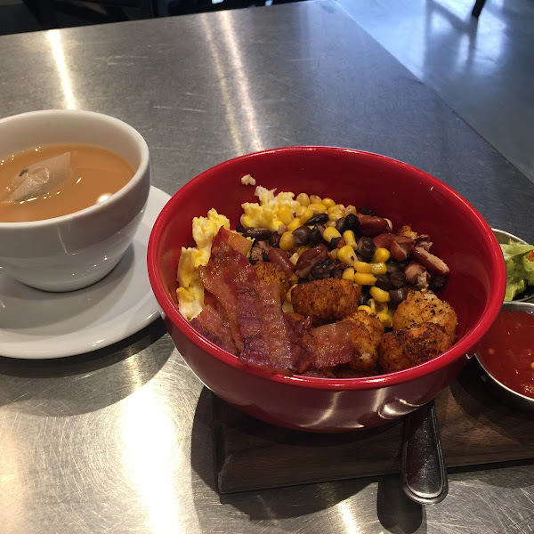 GF Breakfast Nest $9.  Delicious!  Eggs, cheese, beans, corn, bacon and spicy tater tots, sides of salsa and guacamole.  Worth the wait!  Have a handmade drip coffee or Earl Grey tea.  Casual.