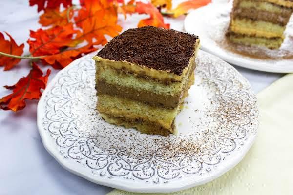 A Slice Of Chocolate Pumpkin Tiramisu On A Plate.