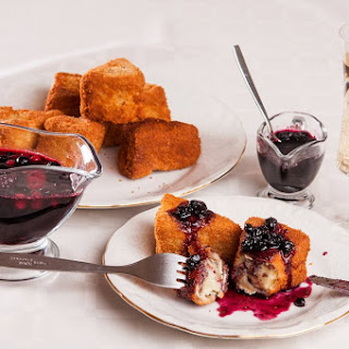 Breaded Camembert Cheese with Wild Berries Sauce.