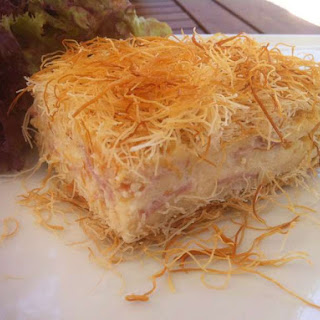 Kataifi Dough Pie with Cheese and Bechamel sauce.