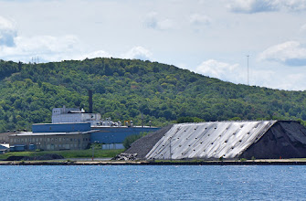 Photo: The plant provides power to Neenah's Munising paper mill. Note stockpile of coal on the right.