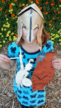Photo: Madeline with her Greek helmet, decorative vase and hinged shadow puppet!