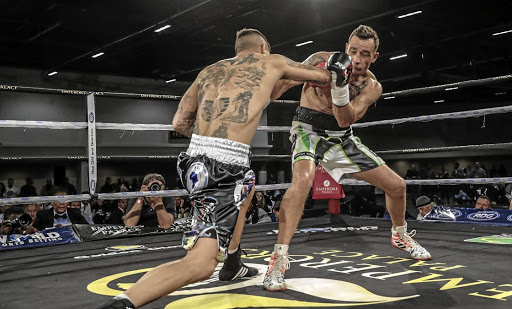 Wade Groth, left, pulverises Wynand Mulder on his way to the interim SA middleweight title on Friday night.
