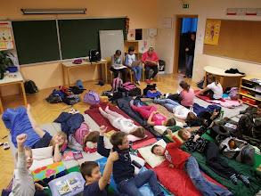 Photo: Starejši učenci OŠ Pivka na Noč knjige berejo mlajšim.