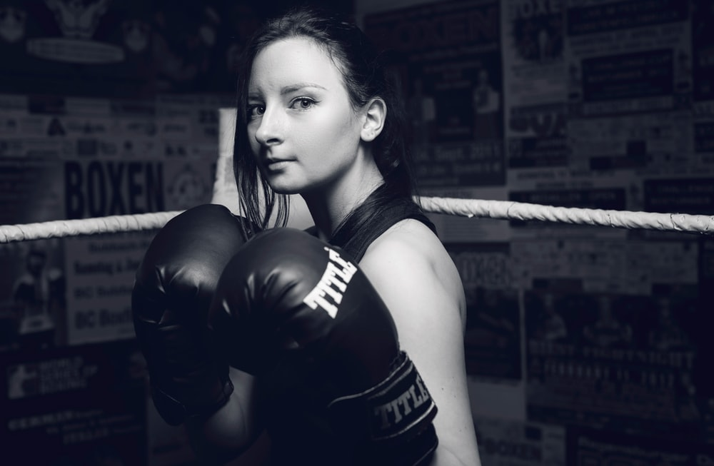 woman wearing black boxing gloves