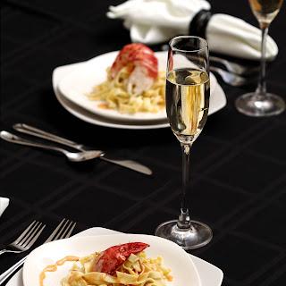 Lobster Fettuccini with Saffron Vanilla Cream Sauce.