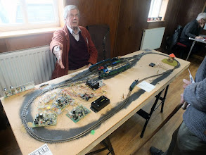 Photo: 019 Shocton Stund, by Richard Stranks is an experiment in automatic control of unmodified DC locmotives. The wiring required to automate running from the 4 road shuffle yard is most impressive !