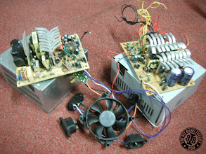 Photo: Disassembling the two ATX power supplies. I bent the heatsinks to make them smaller in height.