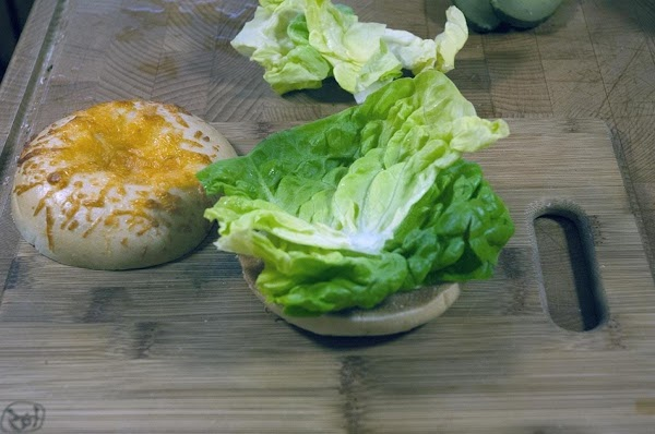 Add a slice or two of lettuce to the bottom half of the toasted...