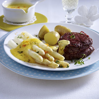 Beef Tenderloin with Potatoes and White Asparagus in Orange Sauce