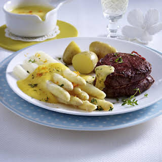 Beef Tenderloin with Potatoes and White Asparagus in Orange Sauce.