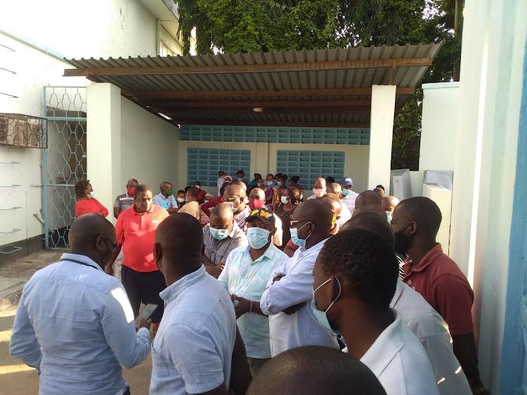 Kaloleni MP Paul Katana [in baseball cap] and mourners at Pandya Memorial Hospital mortuary on Monday.