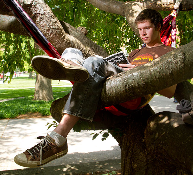 Photo: Will Glarner, son of associate professor of music Robert Glarner,relaxes in a hammock on campus.